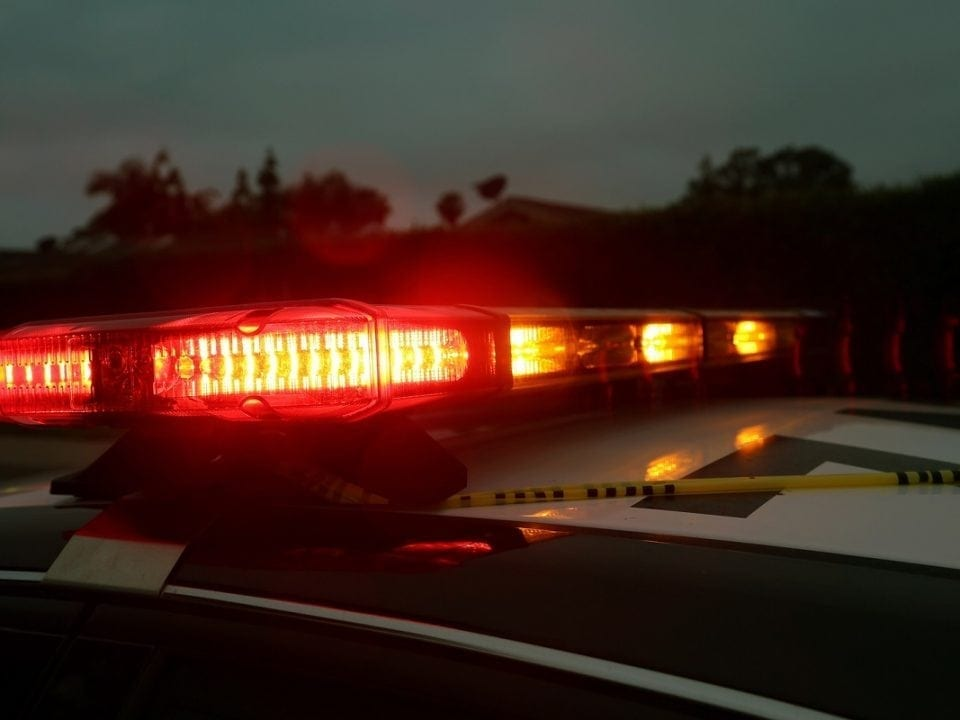 Police Car Light Bar. Light Bar on a police car flashing red and